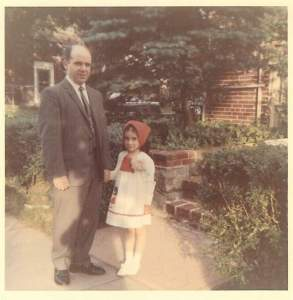 My father, Willy Tirabasso, and young Claudia Jacob (me) in front of our Bronx home.