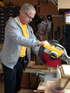 Habitat volunteer Tim McNeilly uses pallet wood from his business, McNeilly Wood Products in Campbell Hall, to craft furniture. PHOTO PROVIDED BY TIM McNEILLY/McNEILLY WOOD CRAFTS