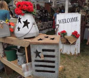 Metal containers such as old milk coolers and watering cans were turned into shabby chic fun. PHOTO BY CLAUDIA JACOBS