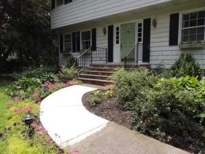 The front walk of this Wallkill home was repaired. Options for painting the walk are explored in this week's Claudia's Corner column