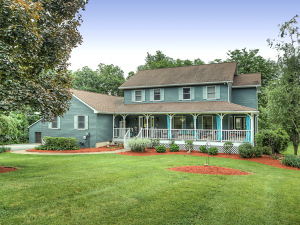 Claudia's own house went from dark cedar brown to a blue/grey last year and it currently on the market. Photo credit: Steve Belner, Photovisions