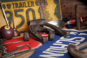 tools, horsehoes, license plates on workbench
