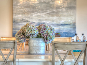 Large, oversized art is the inspiration for the staging of this house. Staged by Claudia Jacobs Designs. Photo Credit: Steve Belner, Photovisions