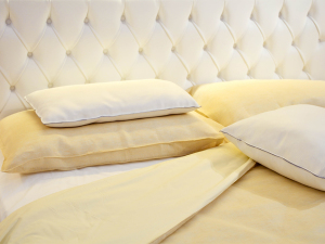 Yellow bed sheets and four pillows