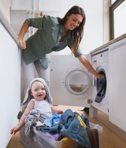 Mother and baby doing laundry together