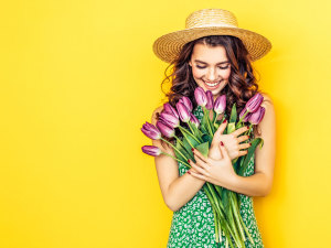 women holding tulips