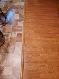 Hall to kitchen is Hardwood to laminate