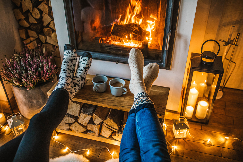People with their feet up to a toasty fire